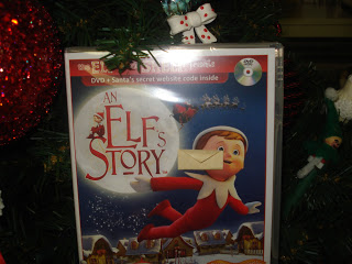 Elfie left a tiny little goodbye note and a copy of the Elf on a Shelf DVD.